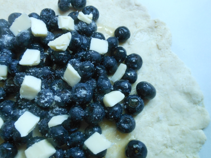 blueberries, honey, and butter sprinkled with sugar