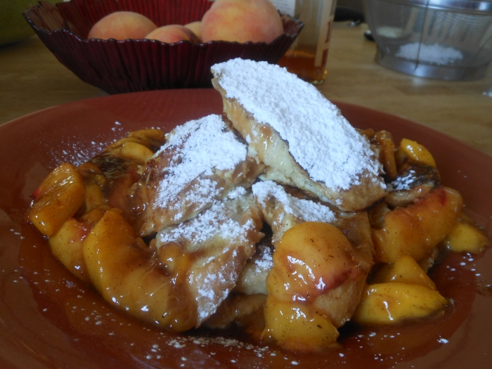 Bourbon Peach French Toast Platter doused in powdered sugar