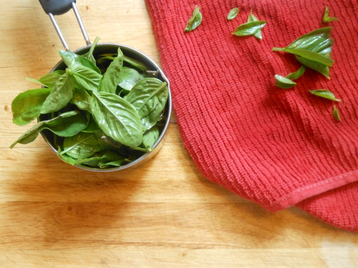 making basil pesto